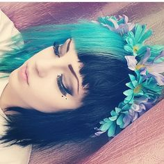 Half black half turquoise dyed hair  I am seriously considering this