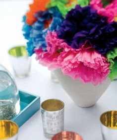 Set a casual table with a bouquet of hot-colored paper flowers, guaranteed not to wilt.