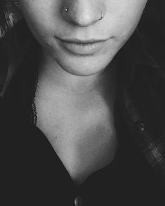 Double Nose piercing. Opposite sides.