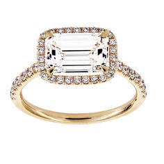 TWO By London East-West Emerald Cut Diamond Halo Engagement Ring: http://www.stylemepretty.com/2016/08/02/east-west-engagement-ring-trend/