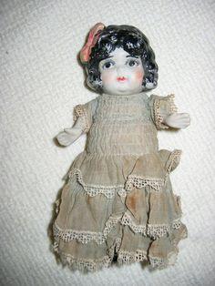 1920's flapper frozen charlotte doll.