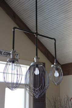 Commercial whip attachments as kitchen     chandelier, Julia M. Usher.
