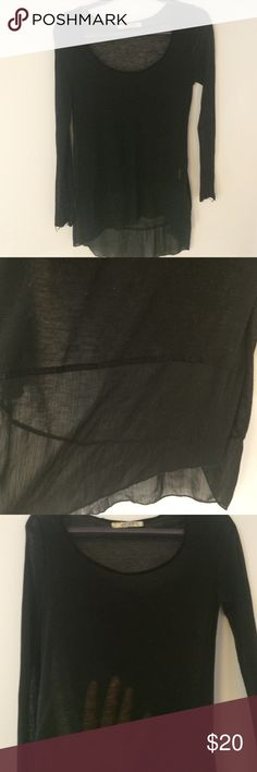 Lovely Black Jersey and Chiffon FP Top Long sleeve t-shirt from Free People. Lovely soft, see-through jersey material with scoop neck. Bottom portion is a high-low chiffon detail. Signs of wear but still good! Great with leggings! Free People Tops Tees - Long Sleeve