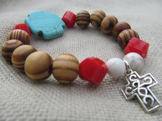Wood, white howlite and poppy red glass beads with turquoise howlite cross and silver cross charm bracelet by littlecrowshop, $25.00