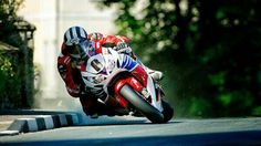 Michael Dunlop kicking up the dust on his way to his Superbike TT win 2013