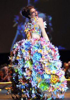 "Amy George wears artist Lauralye Miko's ""Wall Flower"" on the runway of Wearable Art Extravaganza's Cirque de Pluie on Saturday at Centennial Hall. Materials included over 5,000 paint sample pieces."