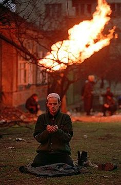 Chechen civilian takes a moment to pray during the war in Chechnya (1990's)