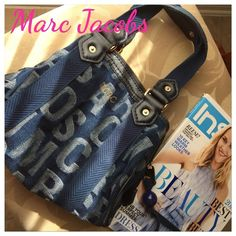 "Reduced  Marc Jacobs Denim Handbag MARC by Marc Jacobs logo-stamped denim tote bag. 11"" W x 8.5"" H x 1.5"" D. Excellent used condition. No rips or stains. Gold hardware. Interior: lined zip pocket with logo plate and two open pockets.  Great condition. No dust bag included. Goes with everything! This is ideal to use with jeans and also dress up. Have gotten a lot compliments on it! Marc by Marc Jacobs Bags Totes"