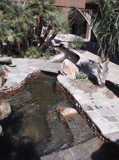 Koi pond with stone bridges over stream