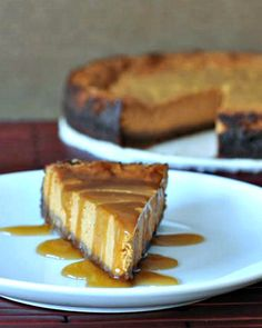 Maple Cream Pumpkin Cheesecake with Buttery Gingersnap Crust - an updated twist combining traditional pumpkin pie with rich cheesecake - a new holiday favorite!