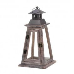 """Elevate Wooden Candle Lantern  ELEVATE WOODEN CANDLE LANTERN 10017536  Rustic wood, dark metal and clear glass combine to make this gorgeous candle lantern. The pyramid design makes this an interesting and timeless accent that will fill your room with glow when you place your favorite candle inside. Candle not included. Dimensions     6.75"""" x 6.75"""" x 13.4"""" 15 1/8"""" high with loop at top."""