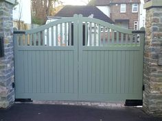 Quality wooden driveway gate with a curved top rail and wooden spindles. These entrance gates have a framed ledge and make ideal driveway gates.