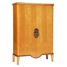Cabinet by André Arbus - so expensive they won't even say how much it costs... but a girl can dream.
