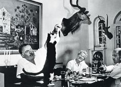 pic: circa Author Ernest Hemingway watched by his wife Mary, feeds tit bits to the cat at dinner. Ernest Hemingway, US writer of novels and short stories and Nobel Prize winner, also a keen sportsman. Ernest Hemingway, Hemingway Cats, Hemingway Quotes, Big House Cats, Maurice Careme, Celebrities With Cats, Men With Cats, Polydactyl Cat, National Cat Day