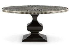 """Dining table - Bernhardt's Barnsley dining table is a striking homage to traditional Indian artistry. Handcrafted of camel bone inlaid in black resin, the 60""""-dia. top rests on a base of ebonized rubberwood 
