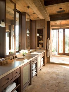 This floor is made with French limestone interspersed with Terra-Cotta Cabochons. Love the optional outdoor shower. Pity about the choice of vanity sinks used, I think a large, Double Trendy trough Gray Granite Bathroom Sink would have been an excellent alternative.