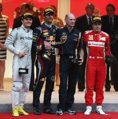 The podium posse. All opted for race suits and race boots in varying degrees of striking livery, emblazoned with badges with all 3 sporting the very latest Pirelli baseball cap.