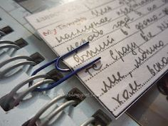 use a paper clip to add an insert into a Smash book...