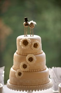 Sweet love bird bride and groom cake toppers from TuckandBonte on Etsy, $125.00.