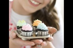 Tiny cupcakes made with condiment cups. Cupcake cake pops? Cupcake bouquet?