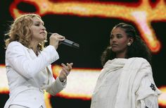 Singer Madonna and 24-year-old student Birhan Woldu, former Ethiopian famine victim and the inspiration for Live Aid 1985, are seen on stage during 'Live 8 London' in Hyde Park on July 2, 2005 in London, England.  Twenty years ago, Woldu's face was featured in a video at Live Aid as a dying child with only 10 minutes to live before she was saved by aid workers.