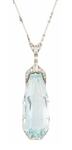Platinum, Aquamarine and Diamond Pendant-Necklace. One fancy-shaped aquamarine ap. 16.00 cts. Length 18 1/2 inches. (Via Doyle New York.)