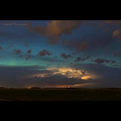"""""""This was a shot I've been wanting to get for a long time. One of my bucket list shots. The huge thunderstorm from June 11/12 brought some amazing lightning. However, I was able to snap some early pics of the lightning with the aurora, at sunset. I've never caught them together before. Taken just east of Saskatoon, SK, Canada."""" By Colin Chatfield #storms #thunder #lightning #aurora #sunset #sky #sun #clouds #nature #photography #exposure #June"""