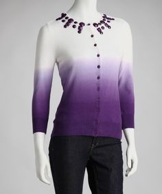 A classic button-up cardigan gets a bold new look with a unique dip-dye design and geometric embellishments along the collar.Measurements (size S): 22'' long from high point of shoulder to hem66% cotton / 29% nylon / 5% spandexHand wash; dry flatImported