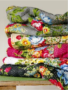floral quilts .. love the hand stitching