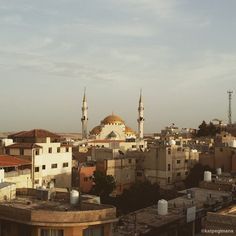 Another sunset view of the mosque in Madaba from the terrace of Moab Land Hotel.