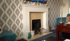 Another fireplace given a stylish update using our Kelly Hoppen Ikat wallpaper.