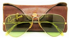 B&L GF under crossbar & on each eyelet. Very Rare RAY-BAN by Bausch & Lomb Aviator WWII. Light wear on these very well kept sunglasses. Case is Genuine Made in USA Leather with aluminum casing, green felt interior. Gold Aviator Sunglasses, Luxury Sunglasses, Ray Ban Sunglasses, Cat Eye Sunglasses, Vintage Sunglasses, Jack Daniels Shirt, Ray Ban Original, Small B, Mens Glasses