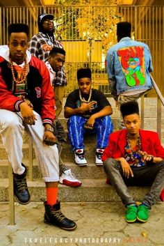 """The 1990's were influenced generally by hip hop, and specifically, by bold graffiti prints. Here you can see a group of men in bright, bold, colors and prints. It was a way to go against """"the man in charge"""" and do what you wanted to do."""