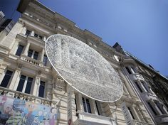 artists sculpt shimmering disk in istanbul with 14,000 eyeglass lenses