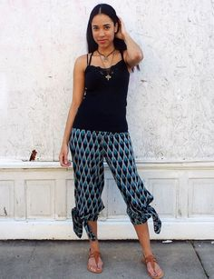 Wide leg, palazzo pants in an ikat aqua teal chevron print. These super comfy, chic cotton pants feature a flat front waistband in the front and an elastic waistband in the back. Fair trade.