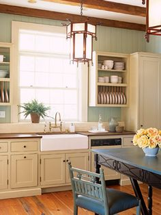 Green Kitchen:   Cabinetry that's painted in Pratt & Lambert's Silver Blond stands out against a quiet green like Farrow & Ball's French Gray 18.