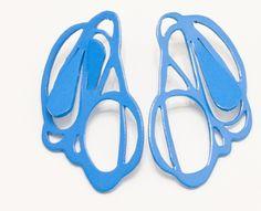 """Laritza Garcia - Ford Blue Earrings  2012 - approx. 1"""" x1""""  Hand pierced powder coated copper earrings"""