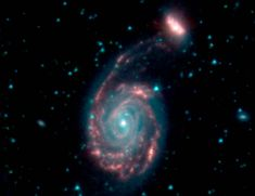 Merger of two galaxies, known as NGC 7752 (larger) and NGC 7753 (smaller)