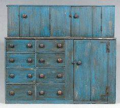 Step back cupboard, single-case construction, top with two doors and shelved interior, bottom with eight drawers and one door with iron hinges, turned walnut knobs, nailed construction, old blue paint, probably late 19th century, 63-1/2 x 70-1/2 x 23-1/2 in.