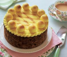 Fruit cake topped with yellow marzipan and yellow marzipan balls