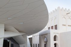 The new futuristic building wraps around the recently restored historic Palace. #dwell #contemporaryhomedesignnews #jeannouvel #nationalmuseumofqatar