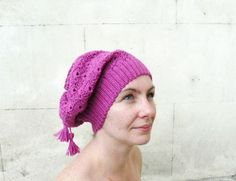 This lovely woman's crochet hat is convinient for the automn and the winter. The purple beanie is realized in hot 50% wool yarn, altough it is soft and doesn't scratch the skin.  I have other colors for you, if you like the pattern, I can crochet it in your prefered colors