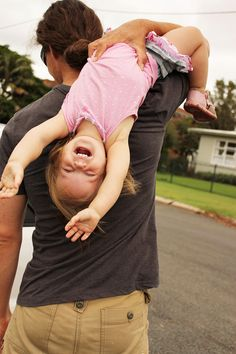 She never fears that Daddy will drop her - she enjoys every minute of his attention. (Mommy, on the other hand, fears that he'll drop her all the time! Hahaha)