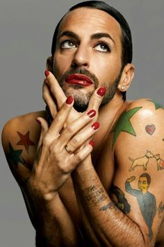 Marc Jacobs - I am sure this guy is a good looking man... whithout all the clown tats and make-up on.