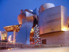 Blue Hour Architecture, Guggenheim Museum Bilbao, Spain (by Batikart) Unusual Buildings, Amazing Buildings, Modern Buildings, Contemporary Architecture, Amazing Architecture, Architecture Details, City Architecture, Contemporary Art, Frank Gehry