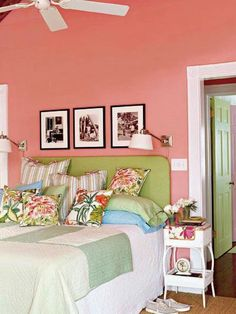 The photographs above the guest bed are of a young Ernest Hemingway, who lived in Key West from 1928 to The black-and-white photos bring old-school charm to this vibrant pink bedroom. Tropical Bedroom Decor, Tropical Bedrooms, Style Key West, Salons Cottage, Room Decor For Teen Girls, Coral Walls, Cottage Living Rooms, Guest Bed, Guest Room