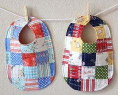 love these baby bibs. especially since they used Children at Play fabric