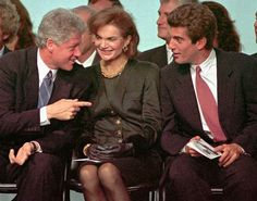 President Bill Clinton, left, gestures as he speaks with Jacqueline Kennedy Onassis and her son John F. Kennedy Jr. during re-dedication ceremonies at the John F. Kennedy Library and Museum Oct. 29,1993 in Boston.    More: