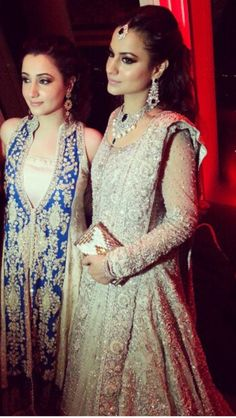 the hair/makeup + jewelry + white salwar are on point