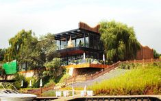 We are a global and creative design studio in Geneva, Tokyo and Beijing. Restaurant Facade, Restaurant Design, Wall Exterior, Exterior Design, Outdoor Sofas, Glass Building, Asian Garden, Swivel Armchair, Garden Trees